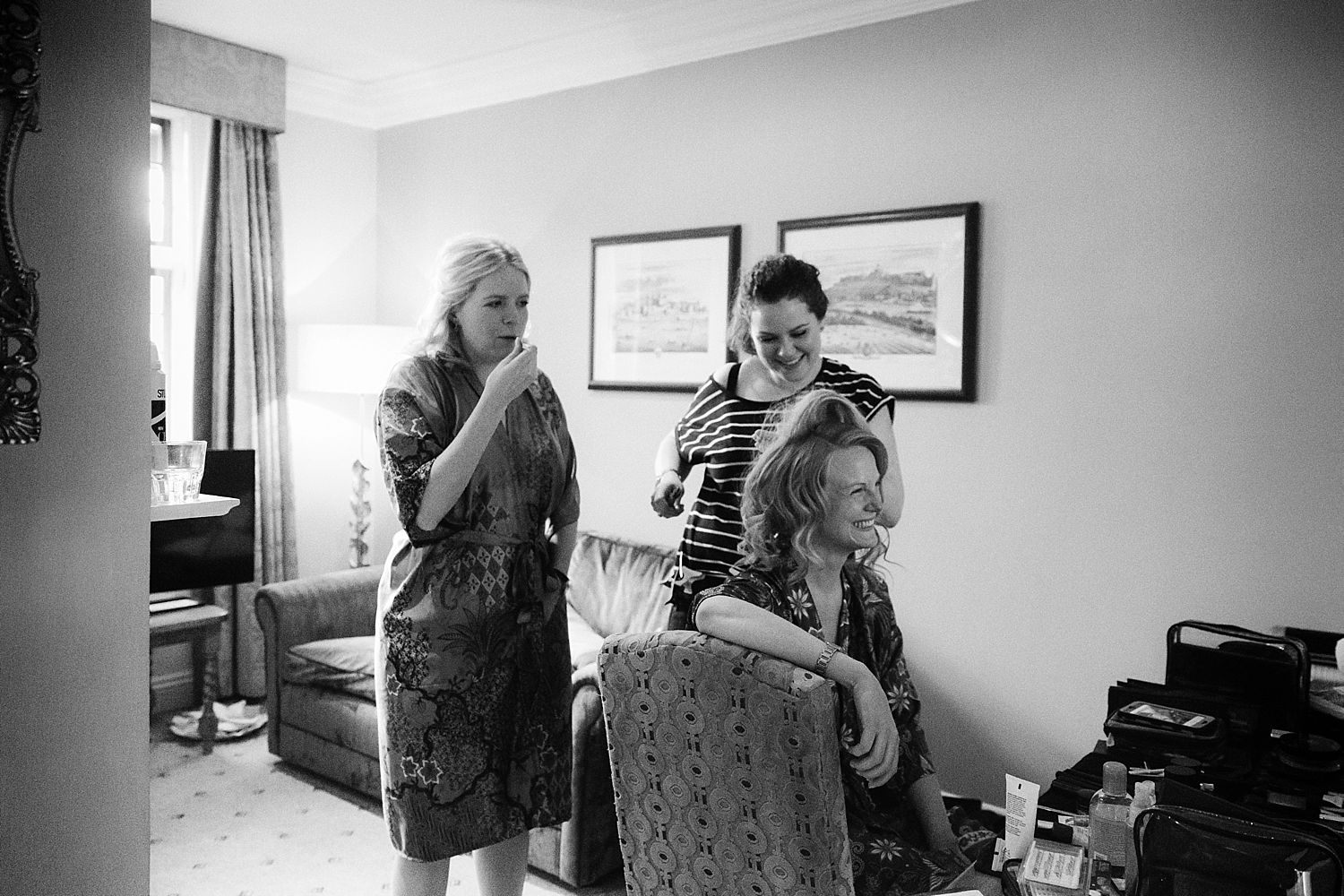 Hair and make up preparation for bride and her bridesmaid at Hampton Court House wedding