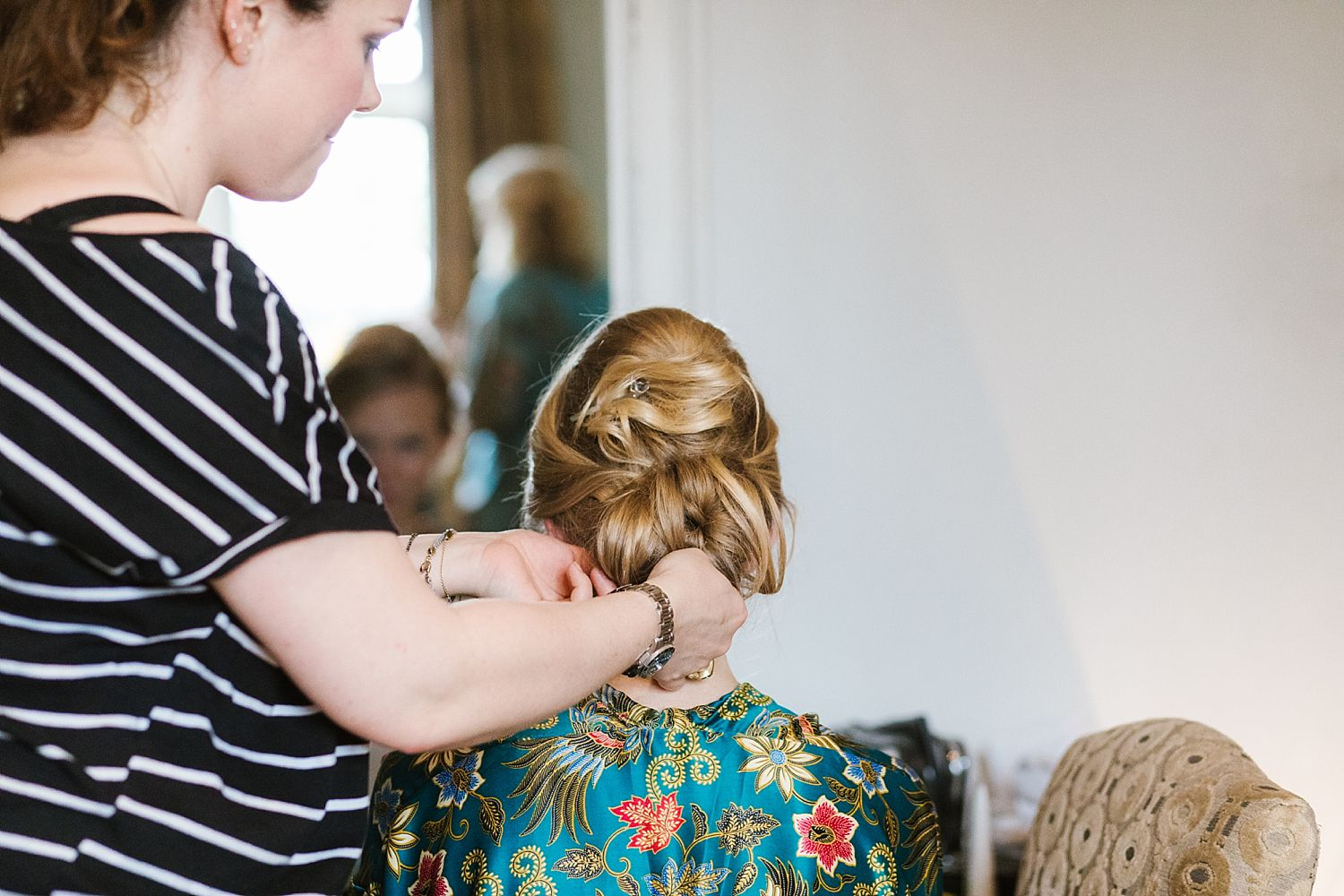 Final touches to bridal hair at Hampton Court House