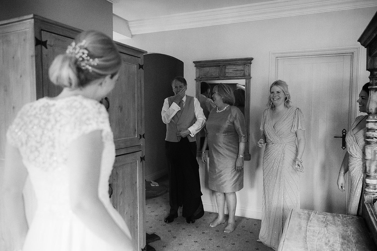 Bride's father sees her for the frst time at Hampton Court House wedding