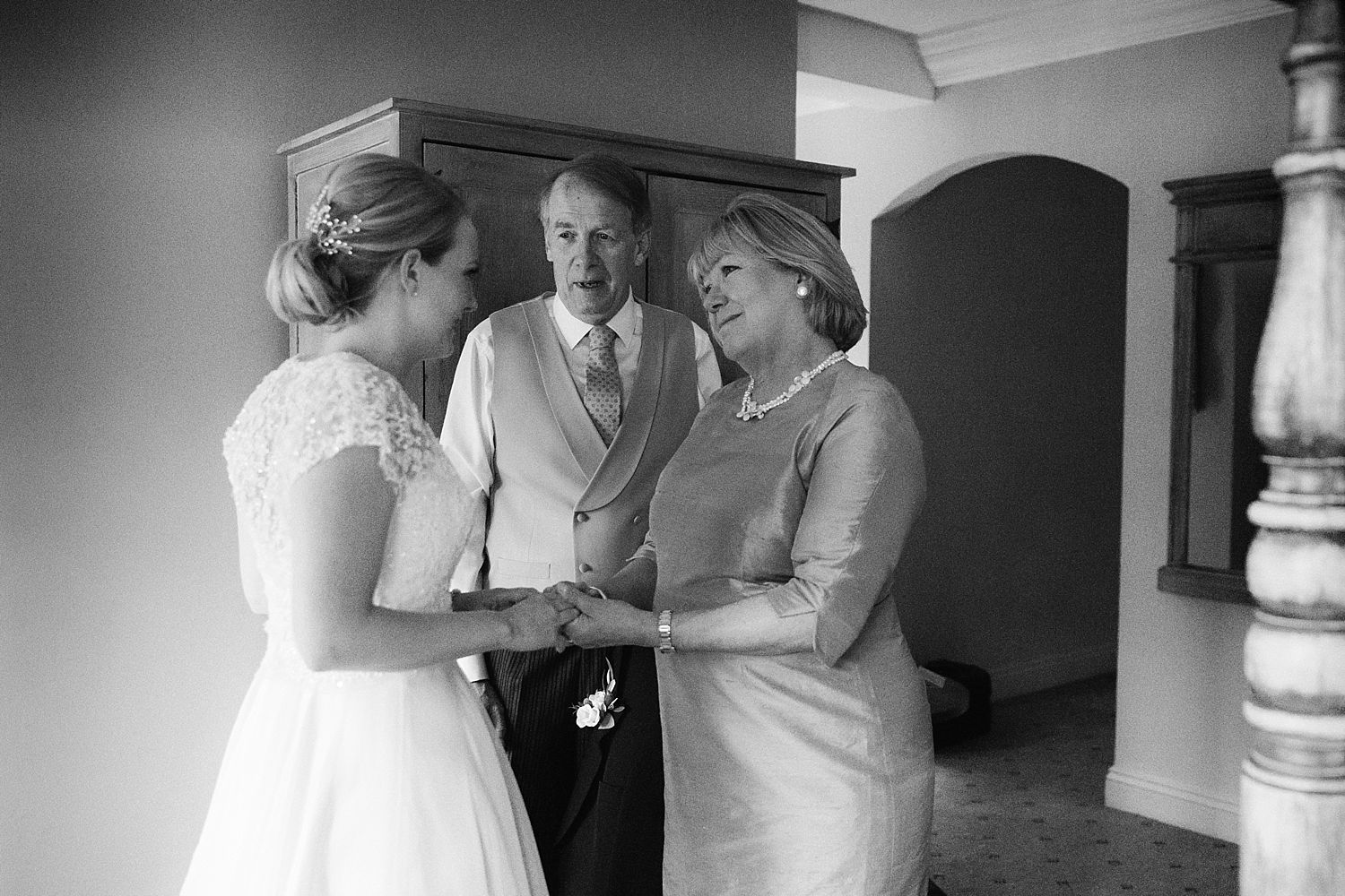 Bride and her parents together before her Hampton Court House wedding. Dress by Stephanie Allin, hair and make up by Lillie Lindh and Kari Rodnes