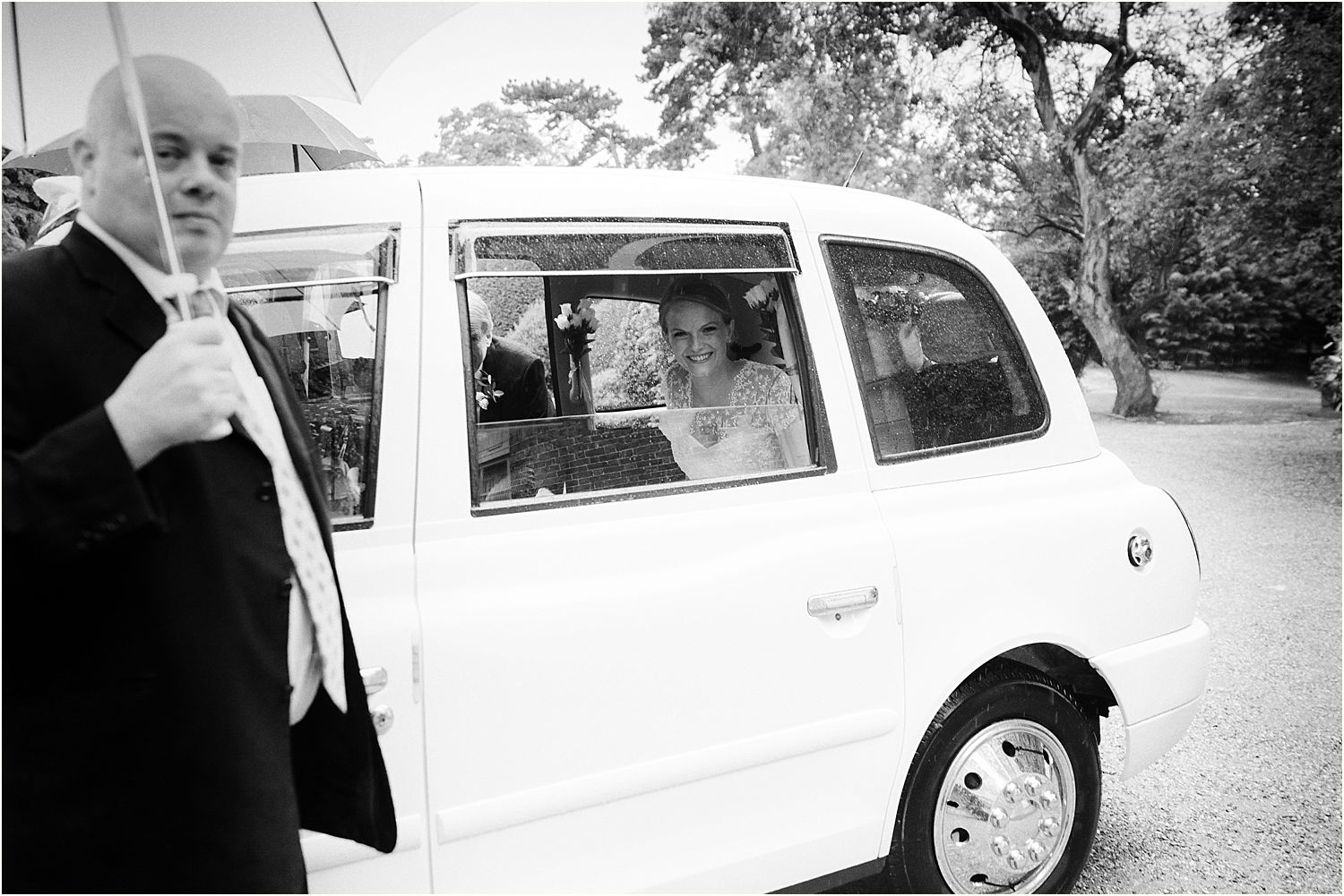 bride arriving in car for her wedding at Hampton Court House Surrey