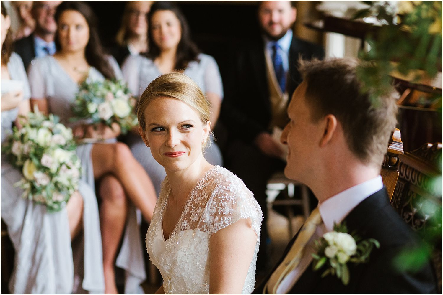 Bride and groom exchange a smile. Wedding dress by Stephanie Allin, hair and make up by Lillie Lindh and Kari Rodnes