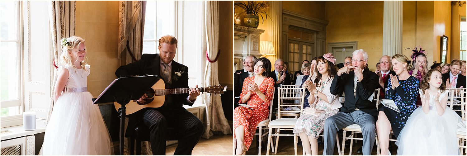 Bridesmaid sings with guitarist during Hampton Court House wedding ceremony