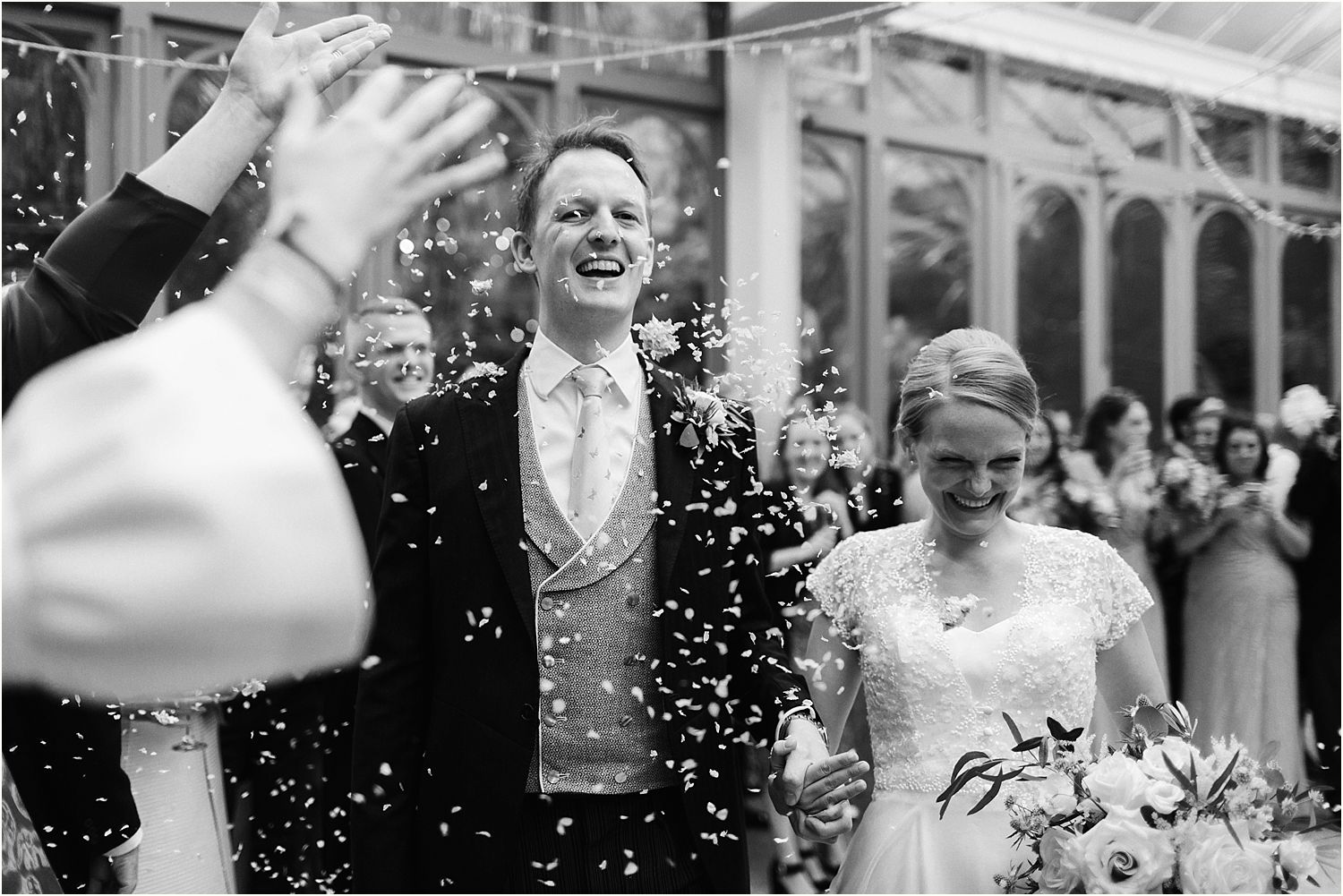 Confetti shower at Hampton Court House wedding Surrey