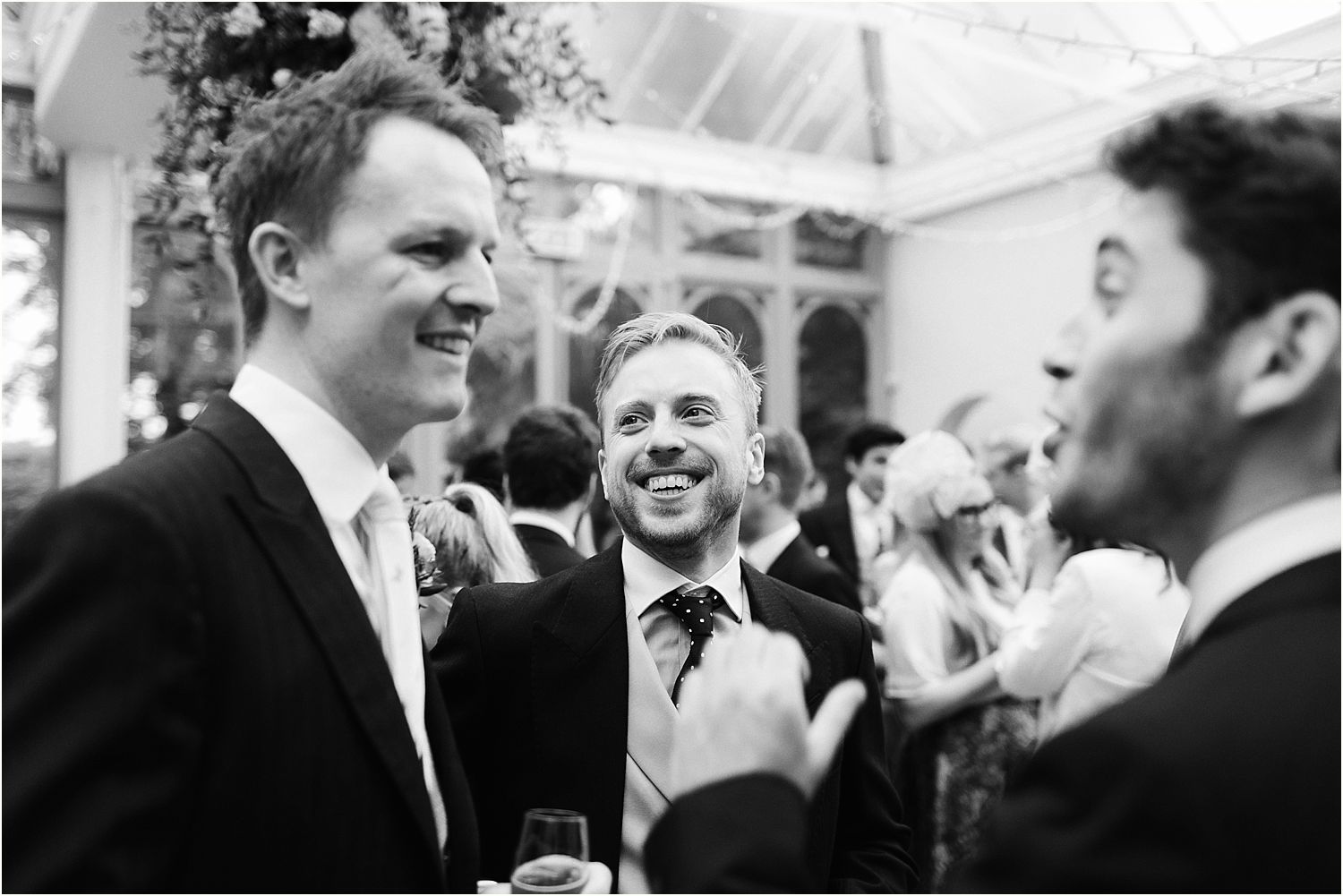 Groom and ushers share a joke at Hampton Court House wedding