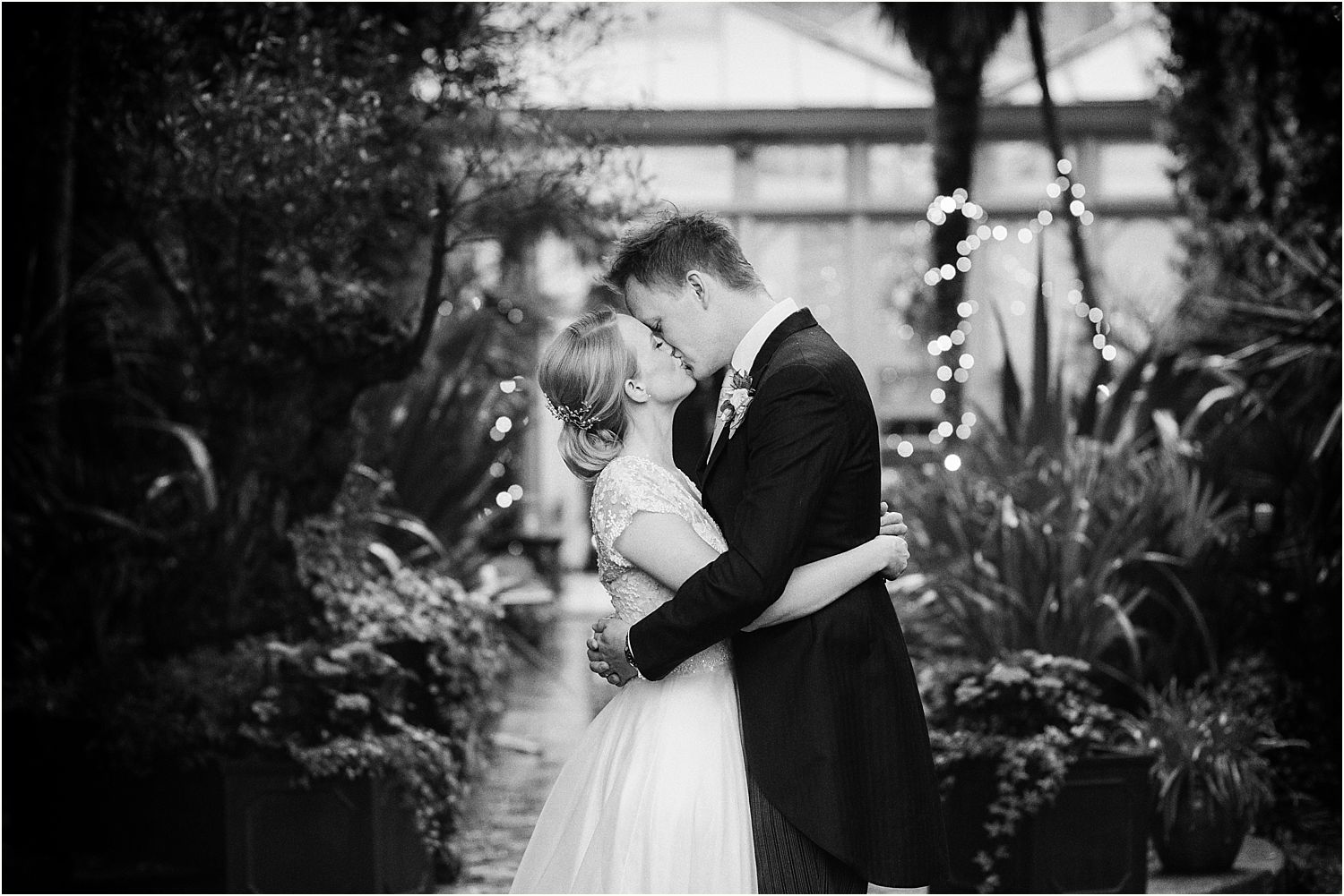 Kissing bride and groom at Surrey wedding venue, Hampton Court House