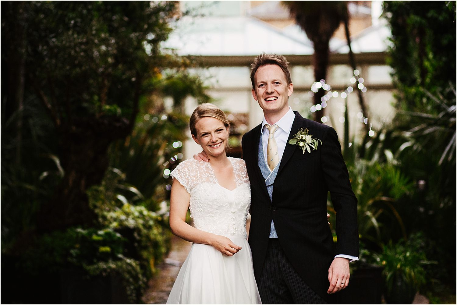 Bride and groom together in gardens at Hampton Court House wedding, Surrey