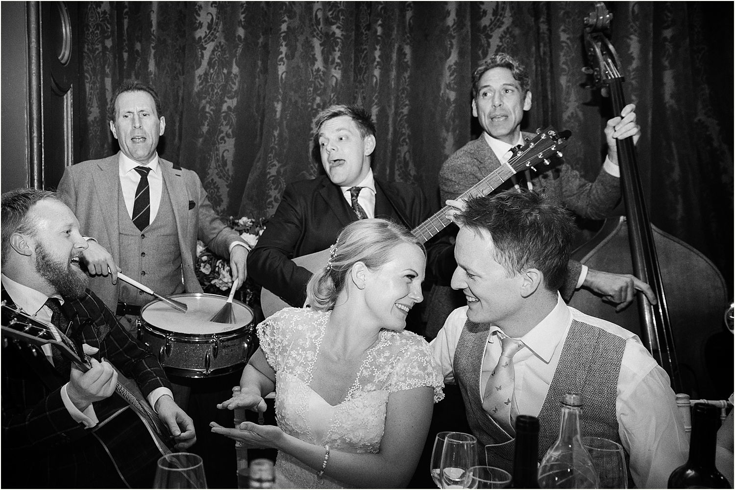 Band serenades bride and groom at Surrey wedding venue, Hampton Court House