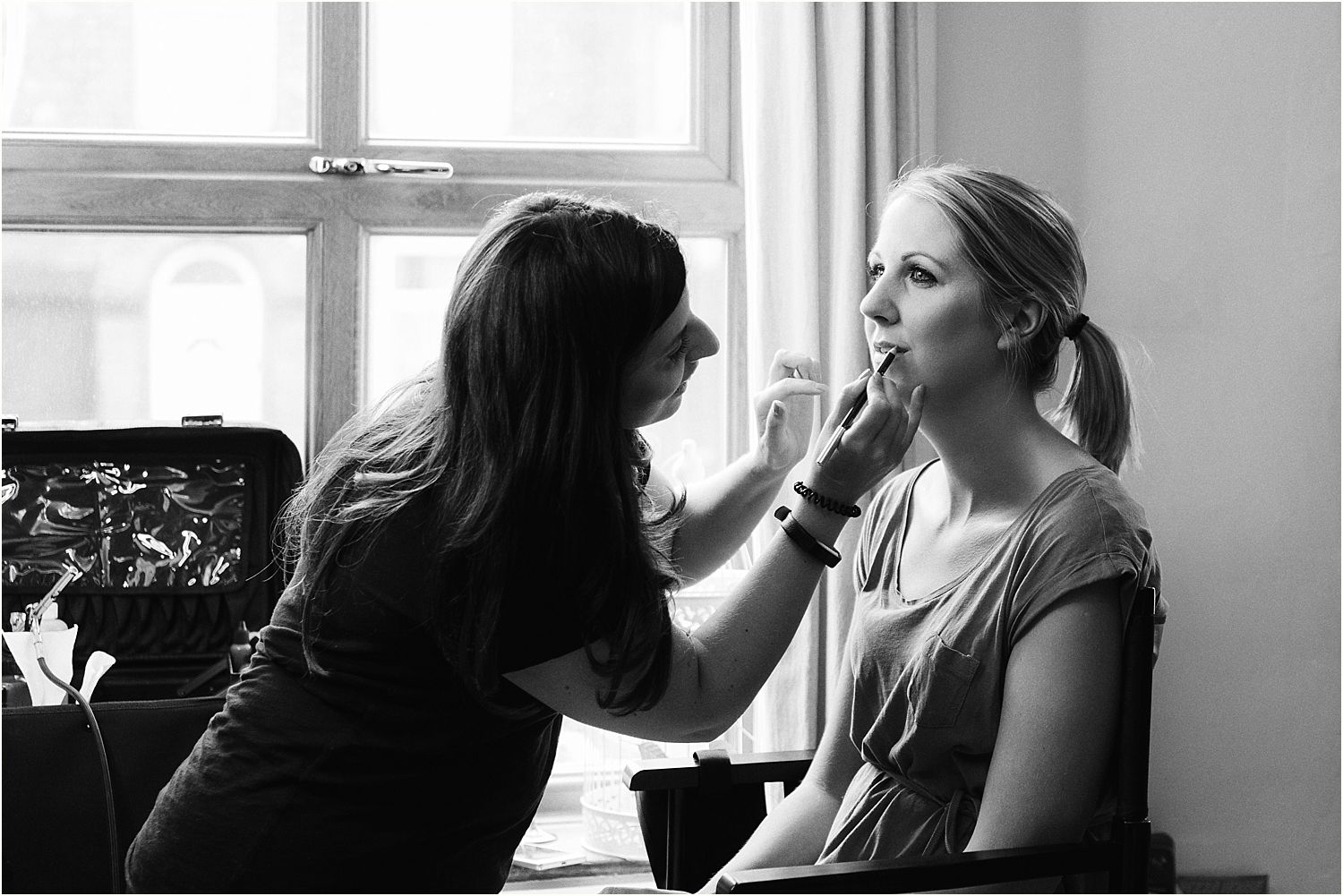 Bridal preparation, bride having her lipstick applied. Bridal make up by Lauren Gooch, using Blush make up