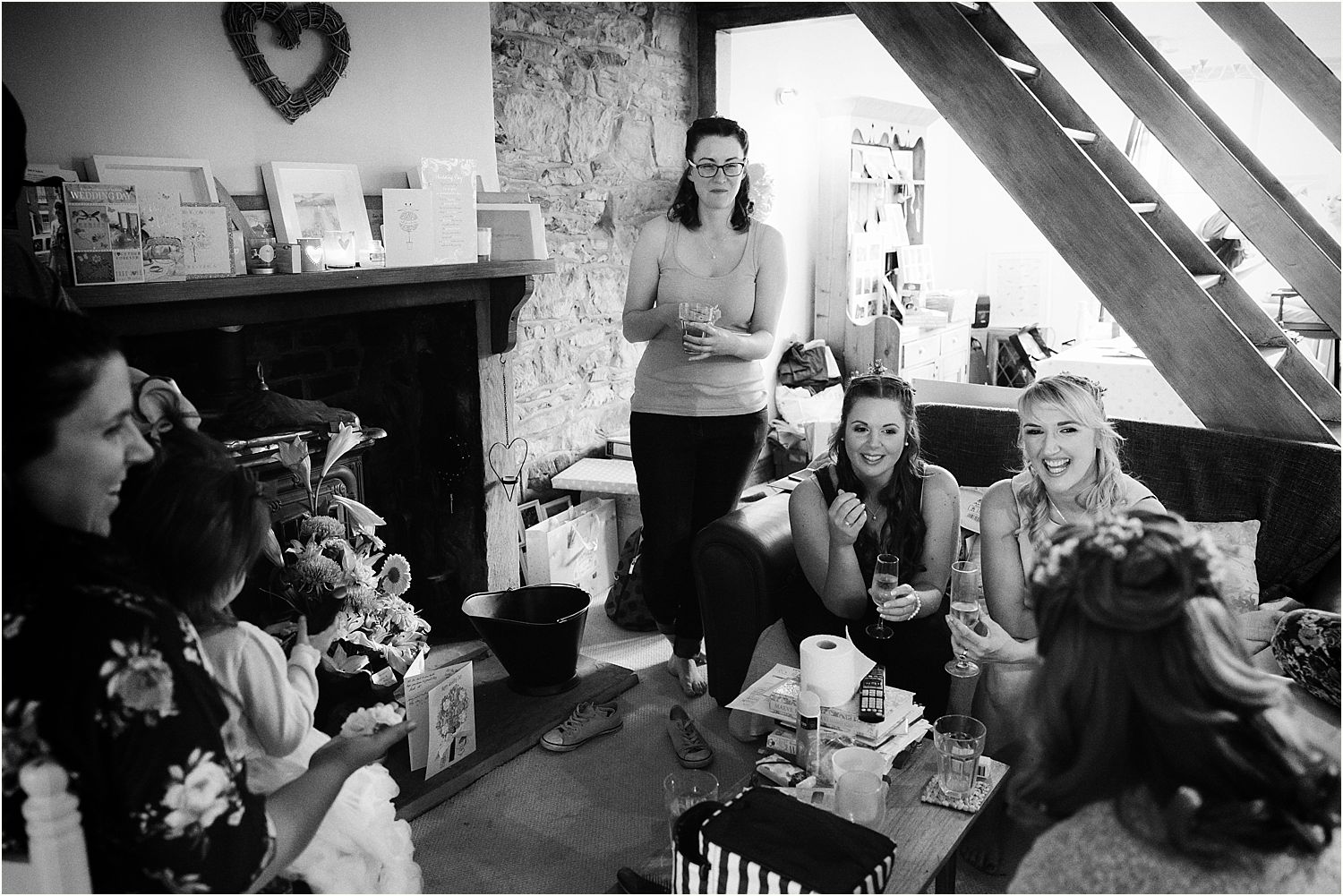 Bride and friends enjoying a relaxing glass of champagne prior to Lancashire farm wedding