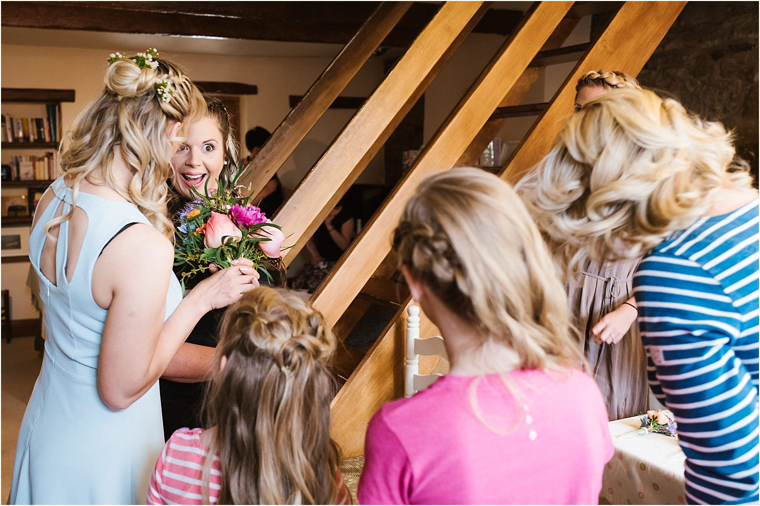 Bride and family chatting and laughing prior to Lancashire farm wedding