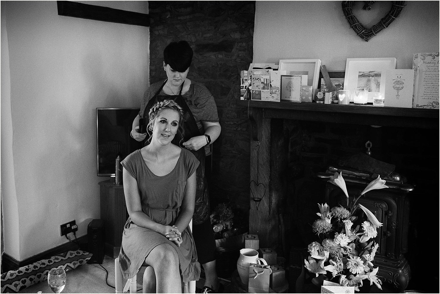 Finishing touches to bridal hair by Lauren Gooch for Lancashire farm wedding