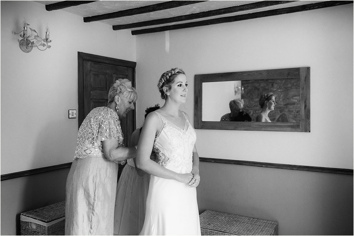 Brides mum buttoning up wedding dress by Maggie Sottero, from The Bridal Lounge in Accrington