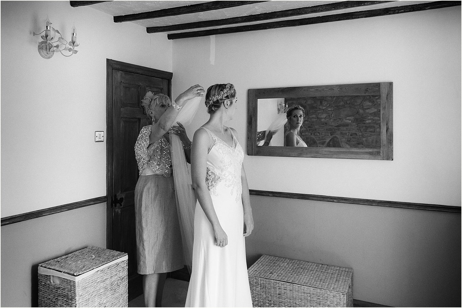 Brides mother pinning the veil in. Accessories from The Bridal Lounge in Accrington