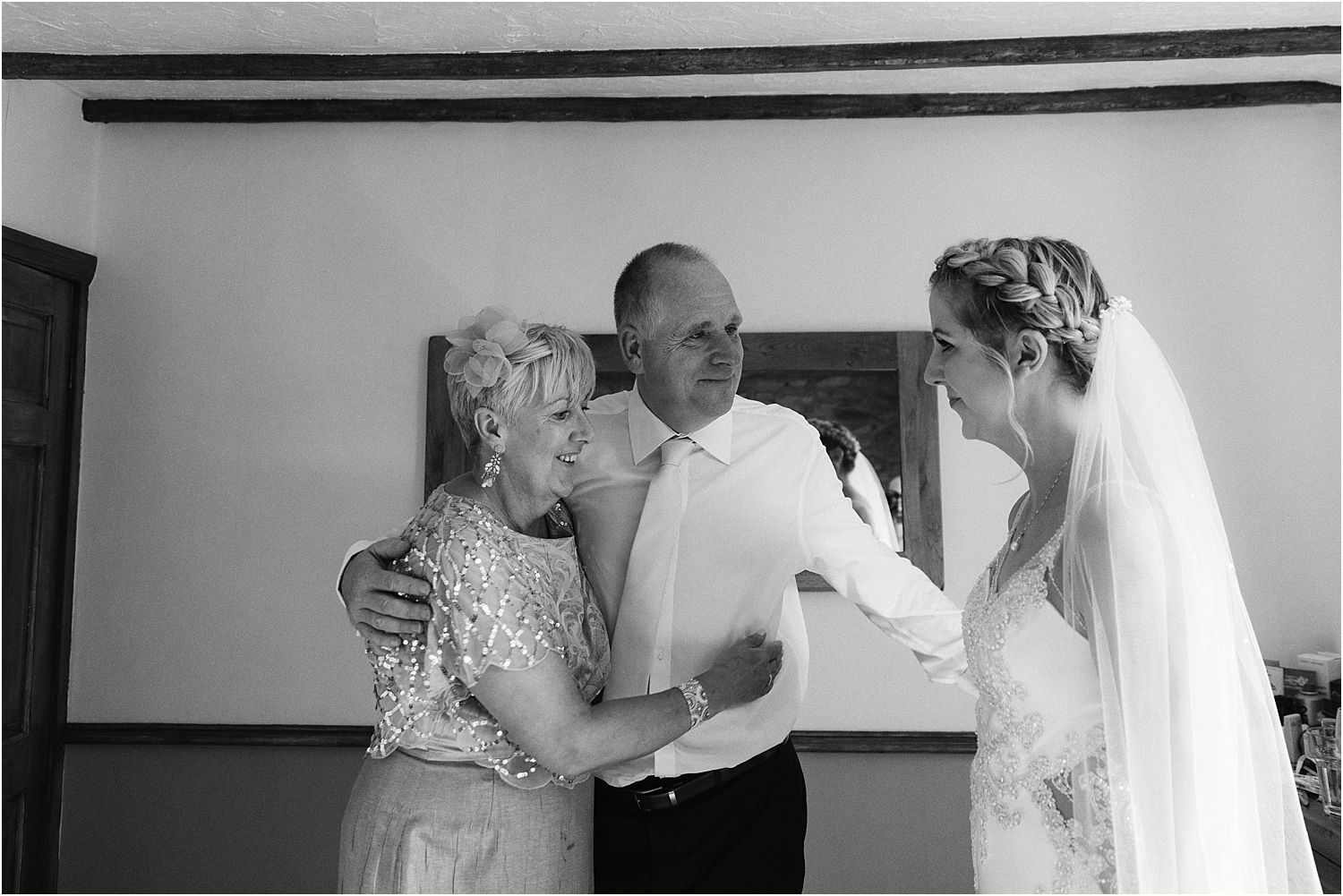 Bride with her parents prior to her Lancashire farm wedding