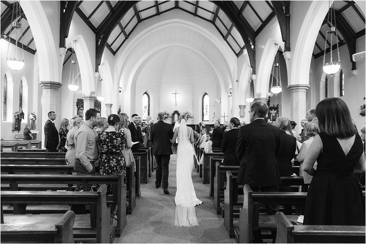 Bride and father walking up the aisle for Lancashire wedding