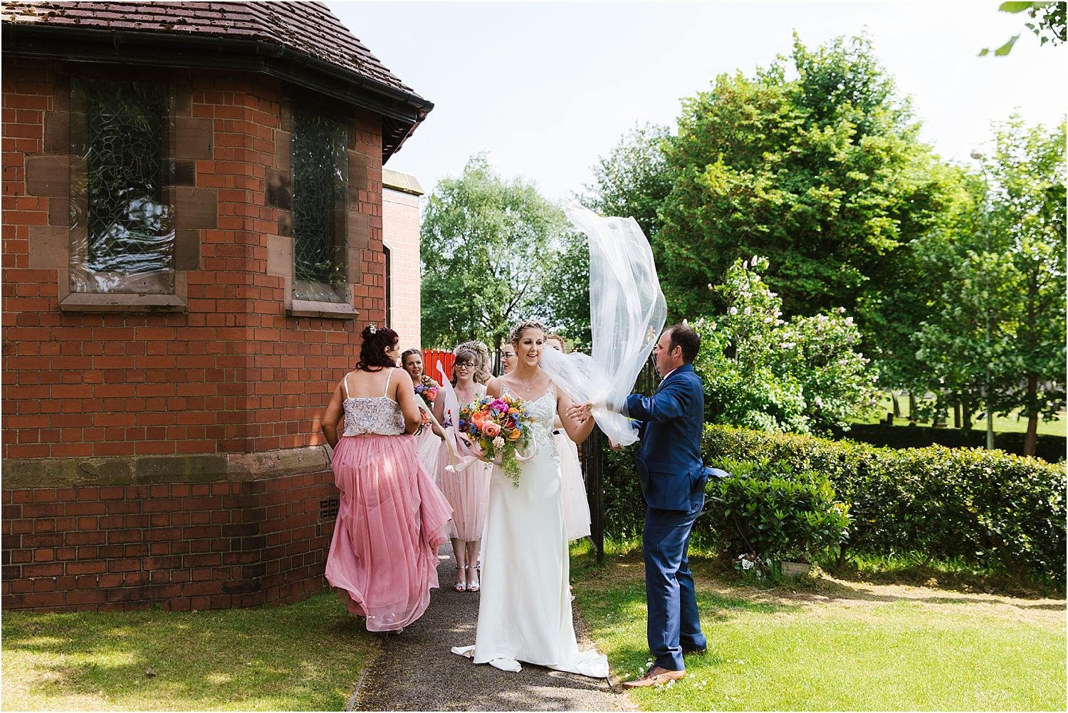 Bride's veil blowing in the wind at Lancashire wedding