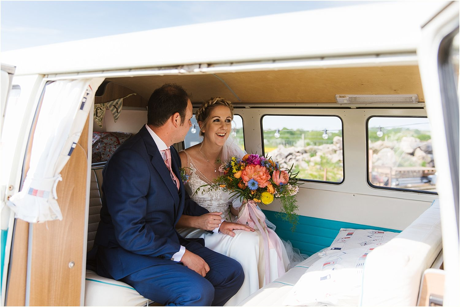 Bride and groom in VW camper van from Nostalgic Campers of Knutsford Cheshire
