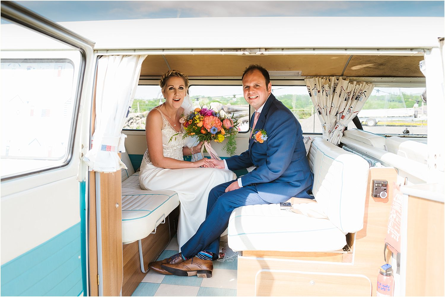 Bride and groom in camper van from Nostalgic Campers, bridal bouquest from Felicity Farm Flowers