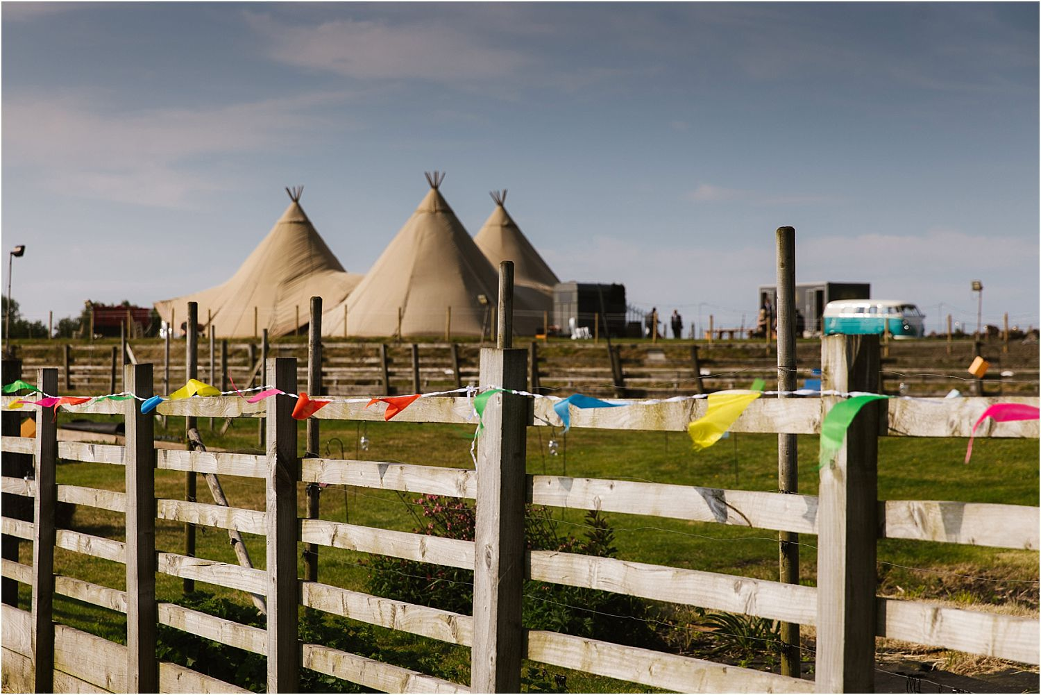 View of tipis at Lancashire farm wedding. Tipis by Betty's Tipis of Chorley