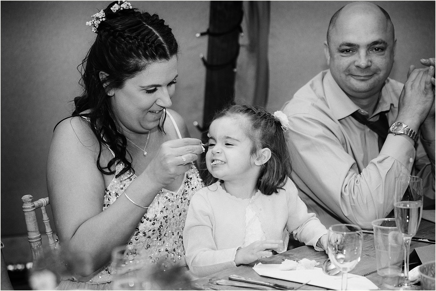 Child guest and parents enjoying reception at Lancashire farm wedding