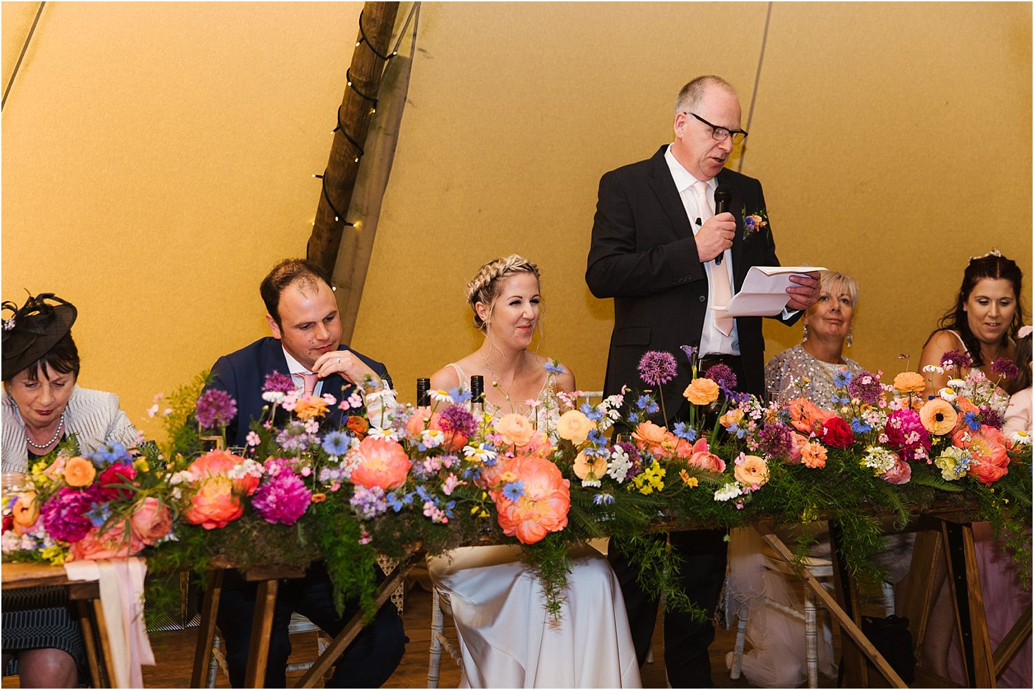 Father of the bride delives his speech at Lancashire farm wedding. Reception flowers by Felicity Farm Flowers