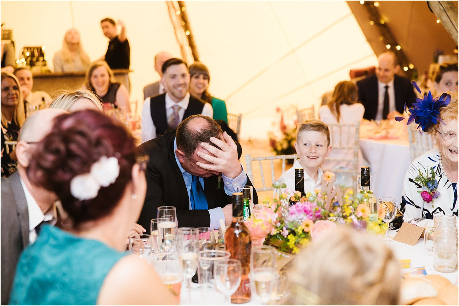 Embarrassed guest at Lancashire farm wedding reception