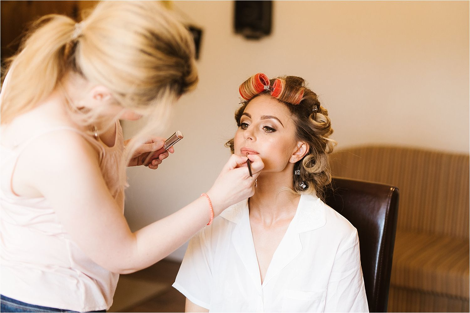 Bride having make up applied by Lizzie Griffiths prior to her wedding at Sandhole Oak Barn