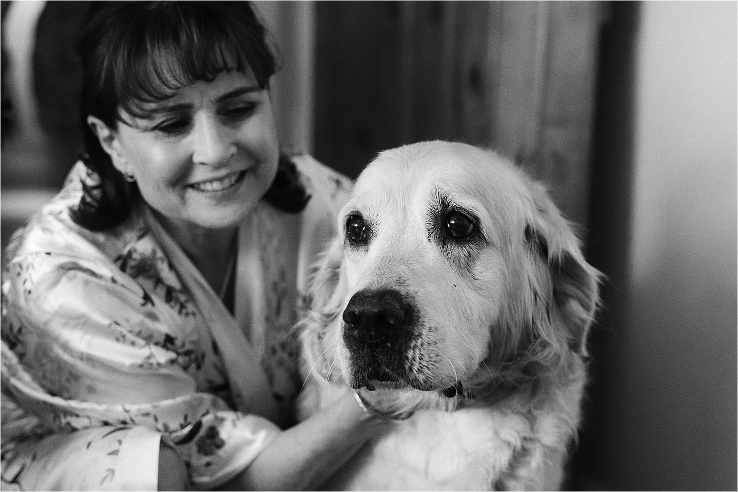 Bride's mother with labrador at Cheshire wedding venue, Sandhole Oak Barn