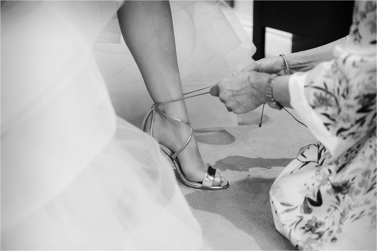 Wedding shoes being laced up at Sandhole Oak Barn wedding Cheshire