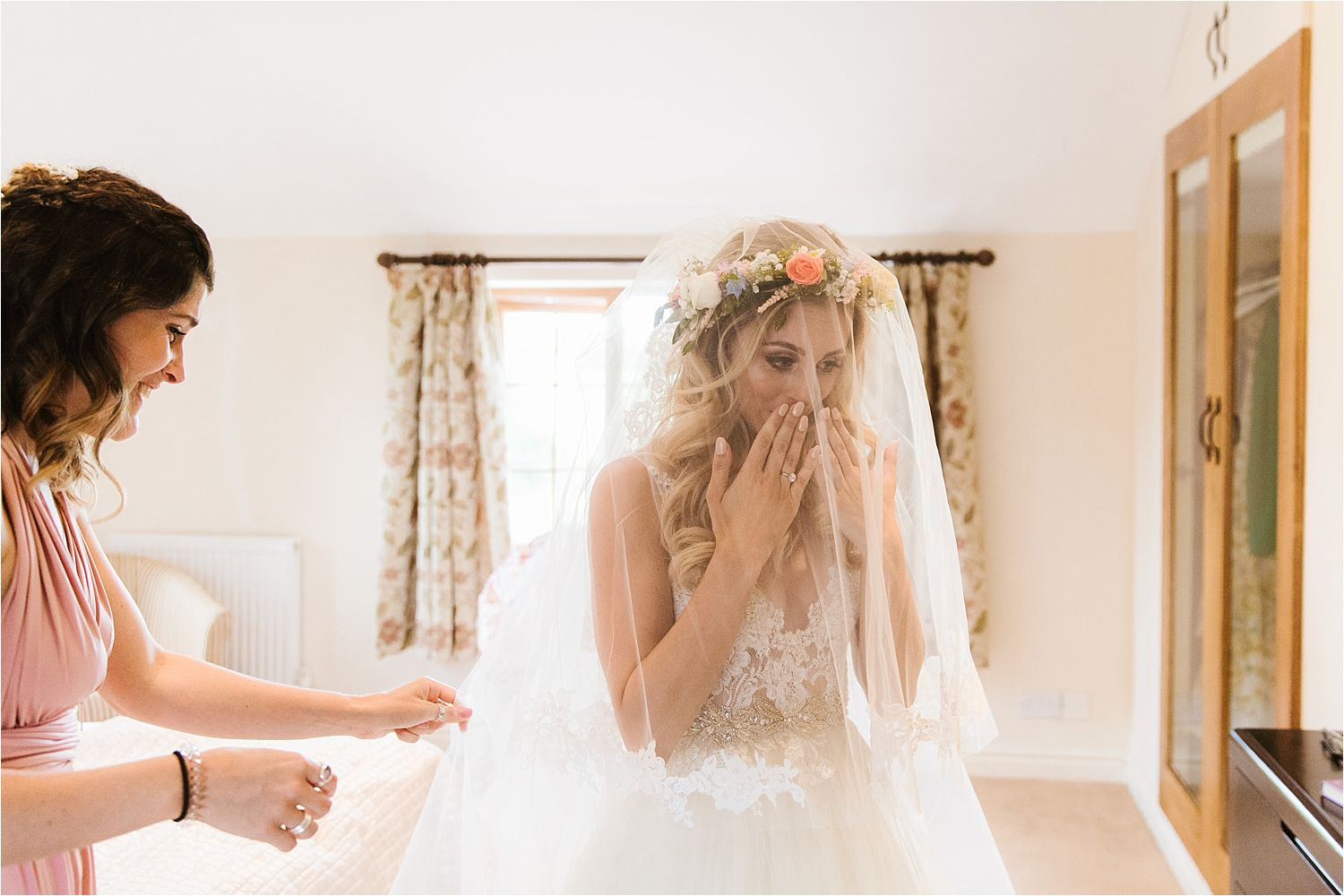 Bride overwhelmed by how she looks hair and make up by Lizzie Griffiths, flowers by Green Earth Flowers