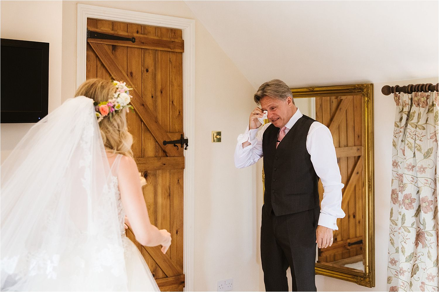 Father of the bride sheds a tear as he sees her ready at Cheshire wedding venue, Sandhole Oak Barn
