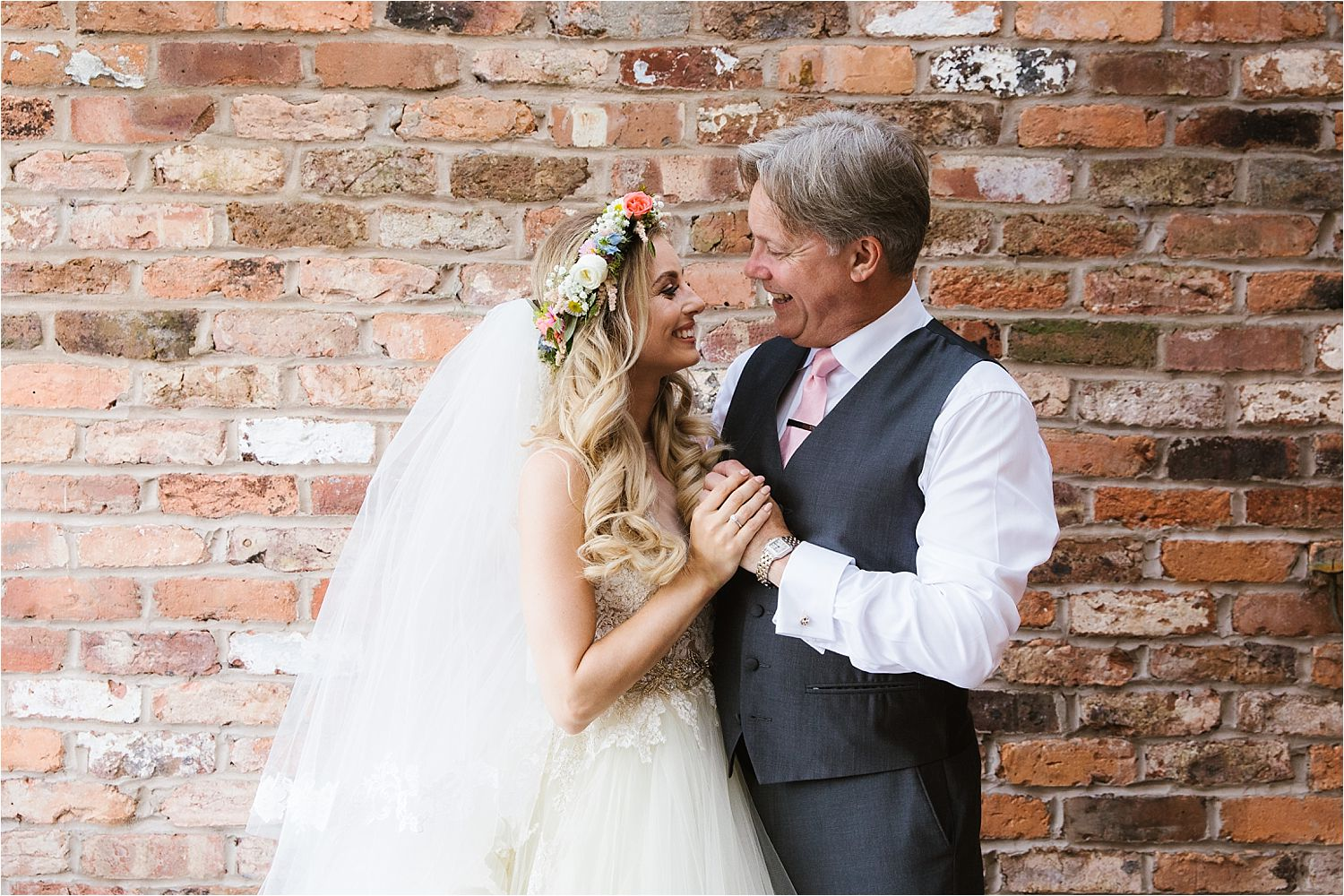 Bride with her father prior to her Cheshire wedding at Sandhole Oak Barn