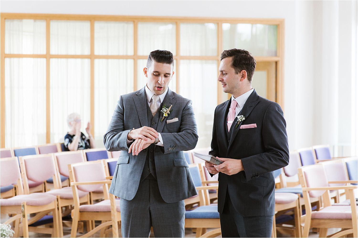 Bridegroom checks his watch prior to his Cheshire wedding. Groom's bespoke suit by The Grooms Room Essex.