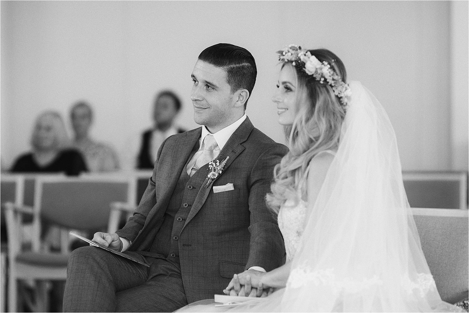 Bride and groom relaxed and smiling during their wedding cerermony, floral headress by Green Earth Flowers