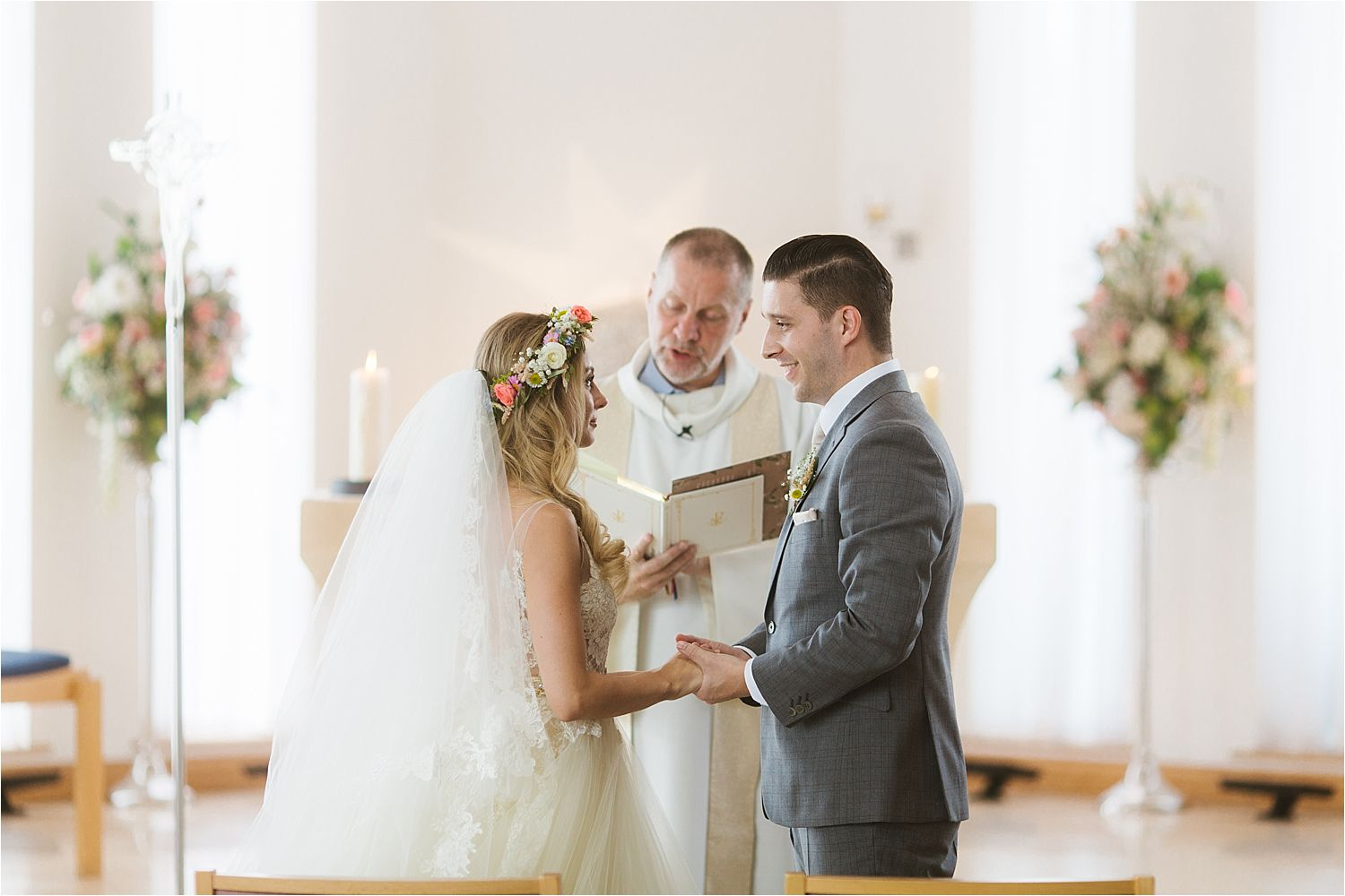 Bride and groom face each other and say their vows at their Sandhole Oak Barn wedding