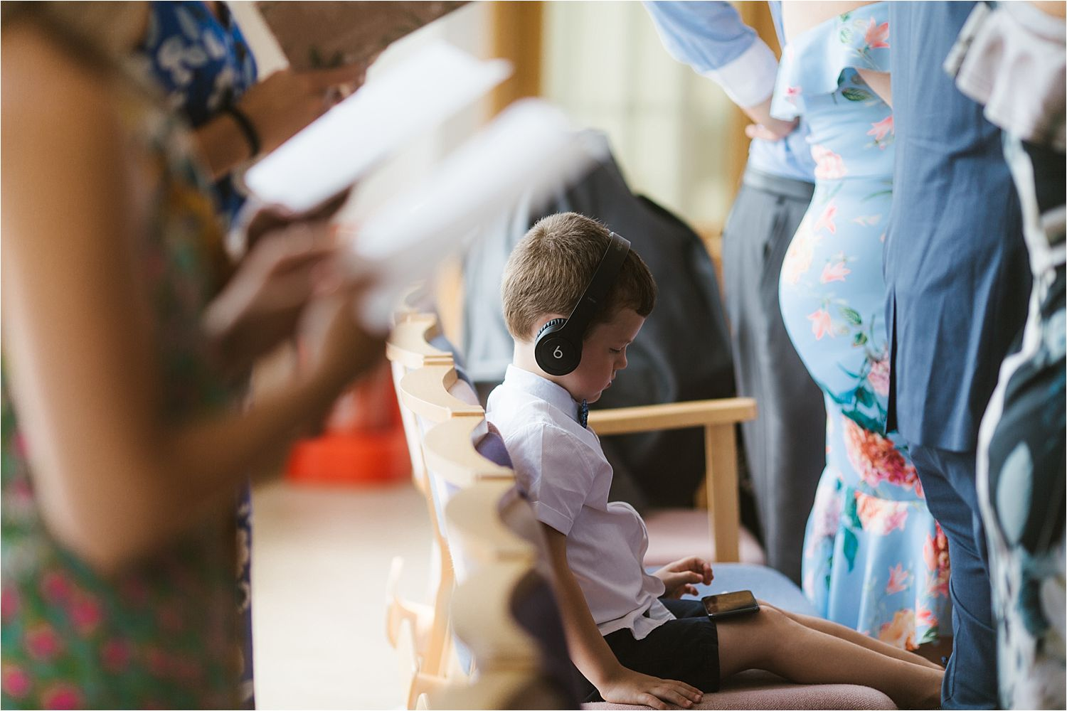 Junior guest with headphones during wedding ceremony at Sandhole Oak Barn
