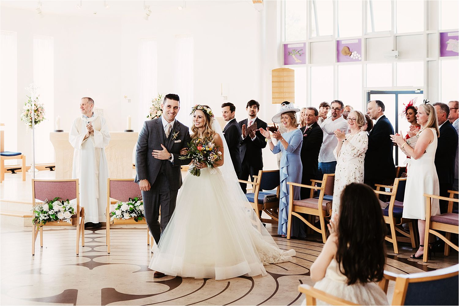 Bride and Groom aftyer their wedding ceremony in Cheshire, Dress by Lazarro