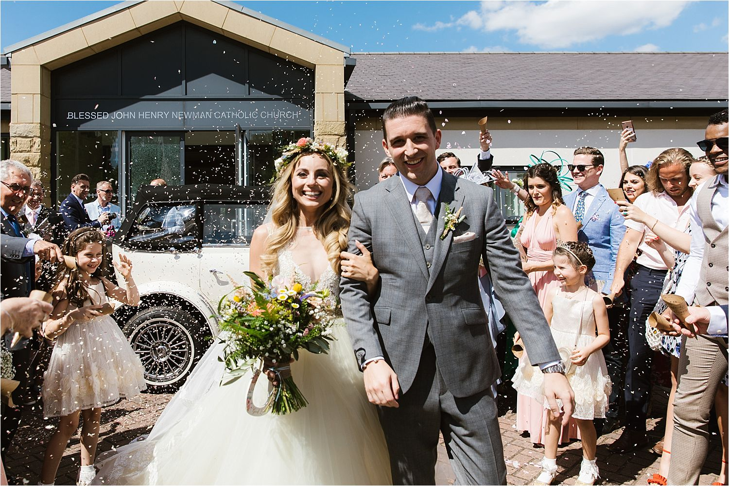 Bride, groom and confetti! Flowers by Green Earth Flowers, Cheshire