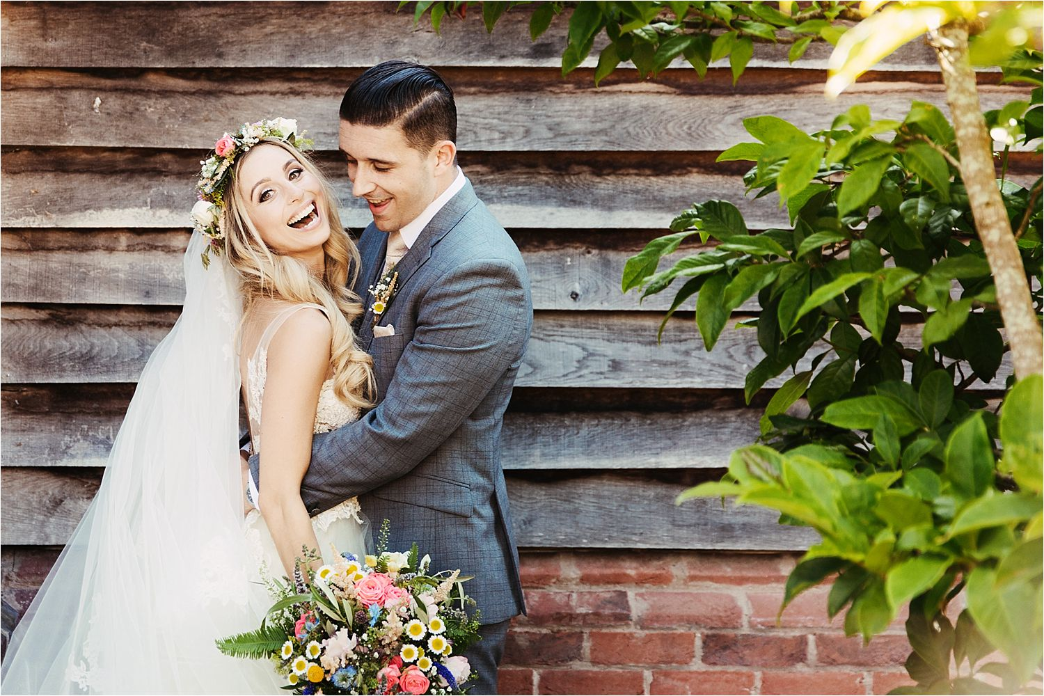 Bride and groom together at Sandhole Oak Barn in Cheshire, flowers by Green Earth Flowers