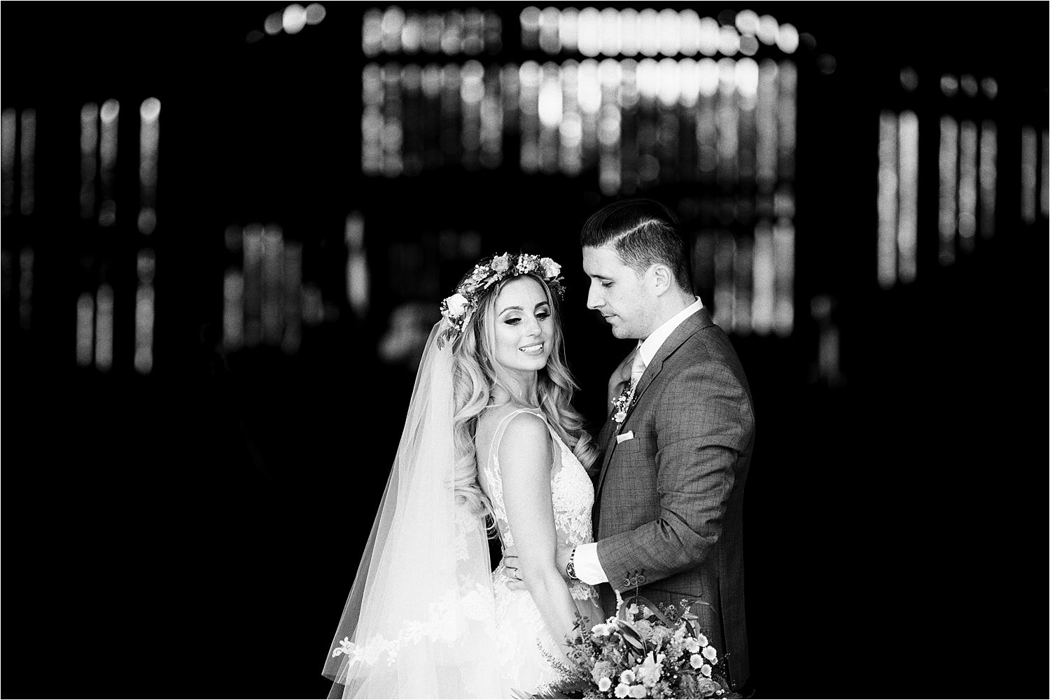 Black and white portrait of bride and groom at Cheshire wedding venue, Sandhole Oak Barn. Hair and Make Up by Lizzie Griffiths