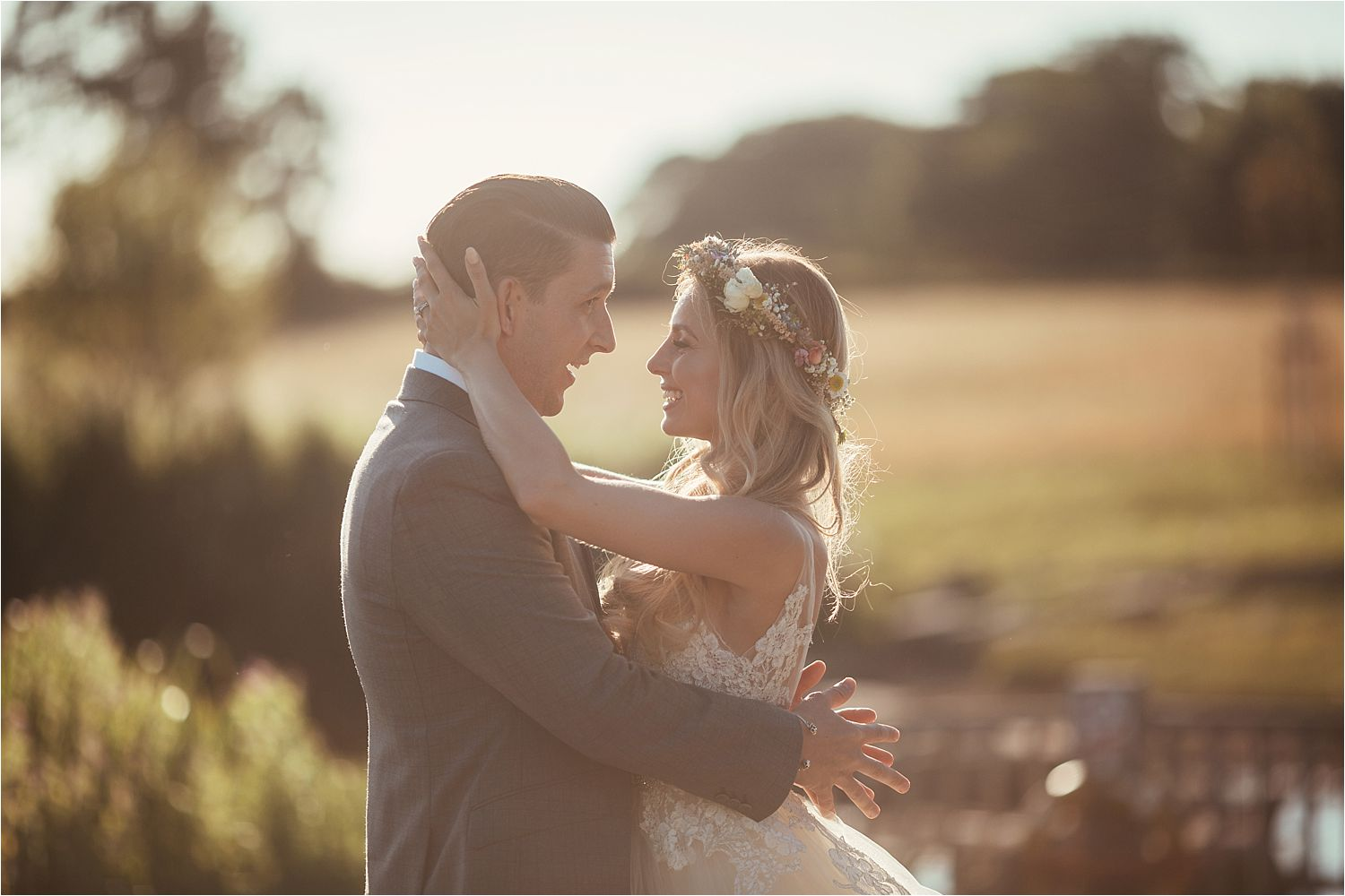 Bride and groom together in ground of Sandhole Oak Barn wedding venue, Cheshire