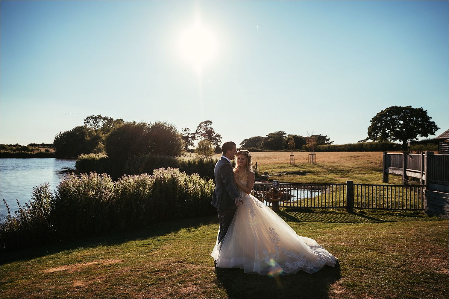 Bride and groom at sunset at their Cheshire wedding, Sandhole Oak Barn