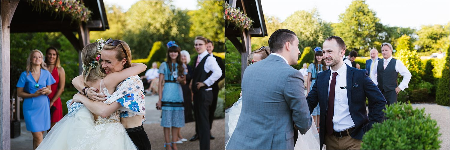 Guests greeting bride and groom after their Cheshire wedding