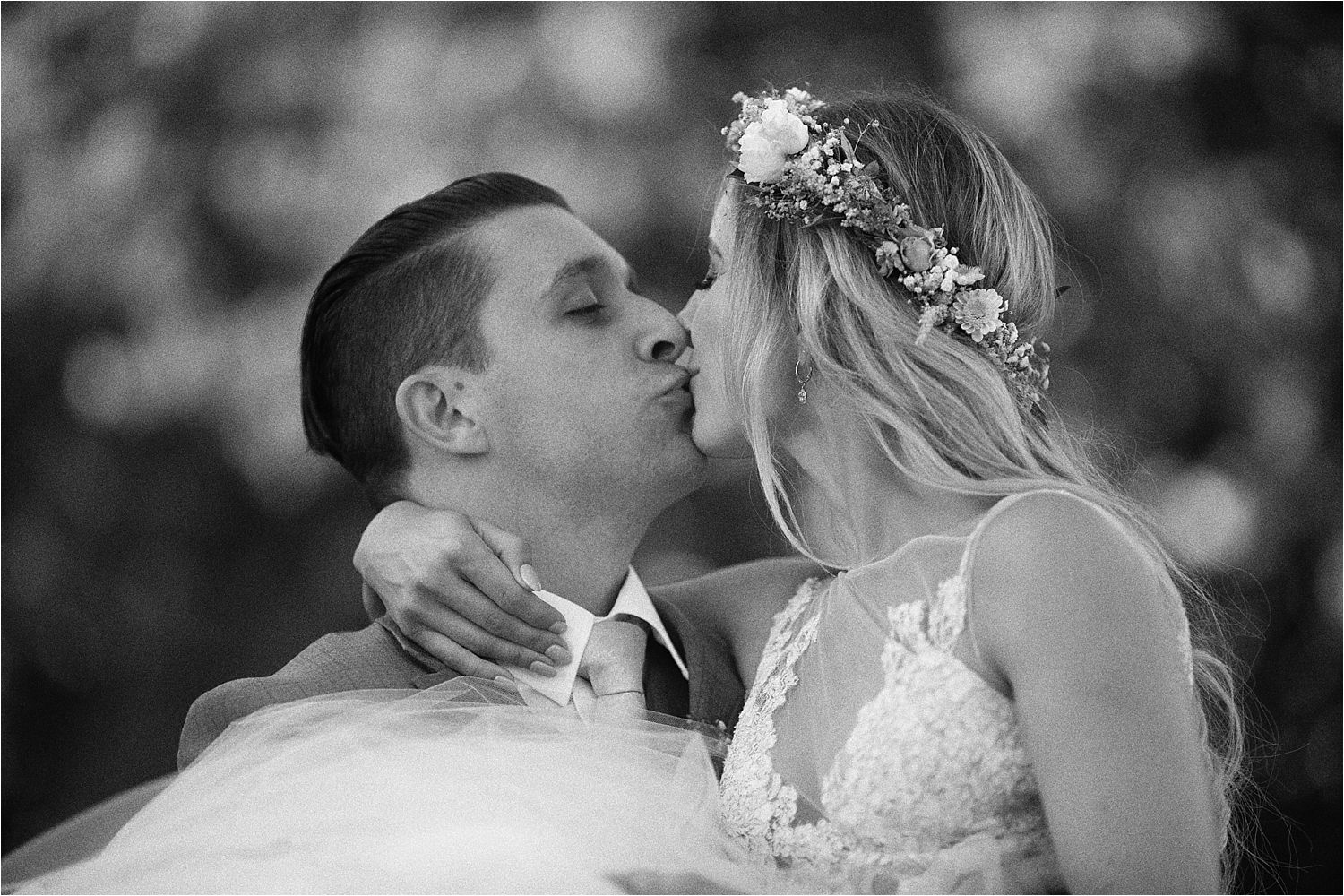 Bride and groom kissing at their Sandhole Oak Barn wedding, in Cheshire