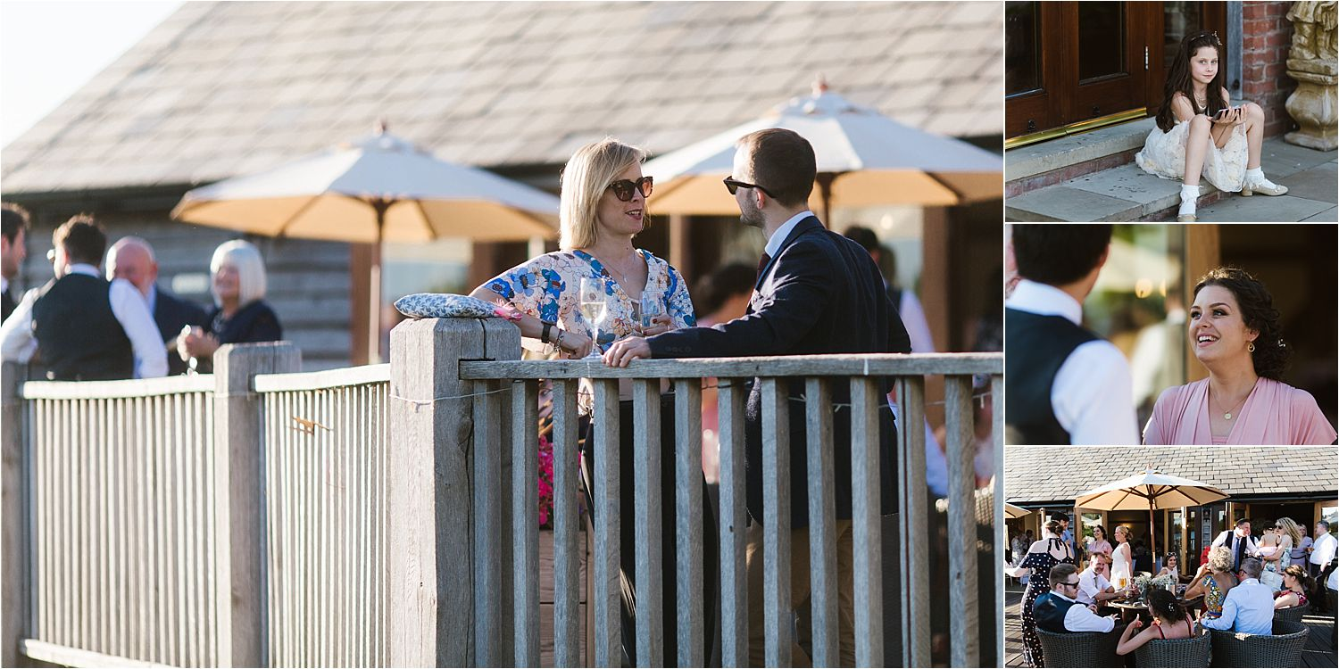 Guests enjoying the evening sun at Sandhole Oak Barn wedding evening reception
