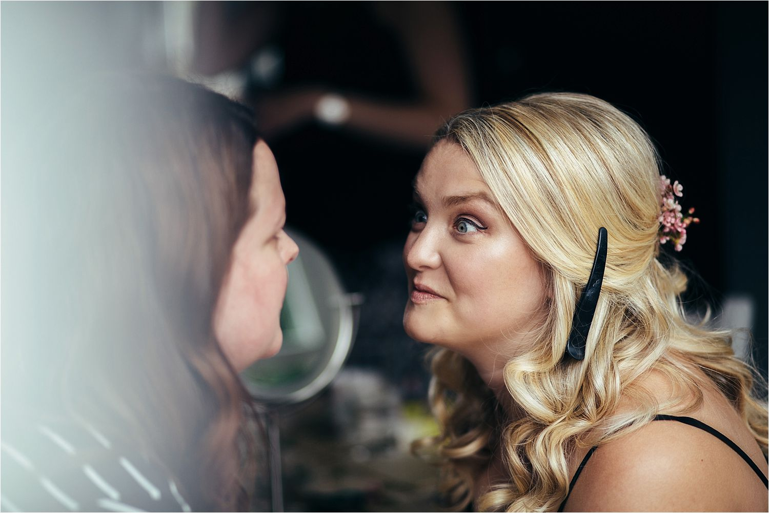 Bride's make up being checked by make up artist