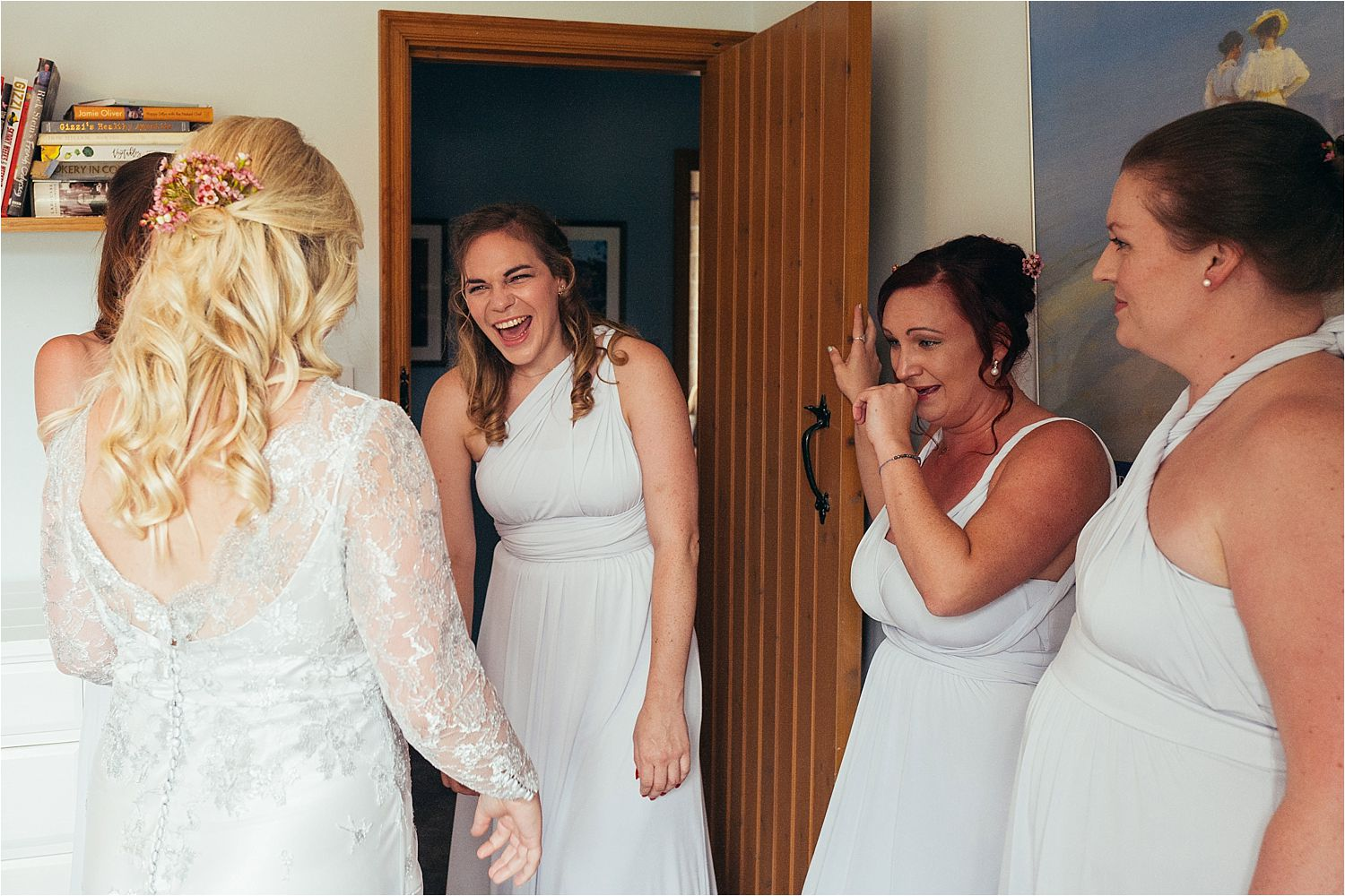 Bridesmaids greet the bride in her Soon Bride dress prior to her Bedfordshire wedding