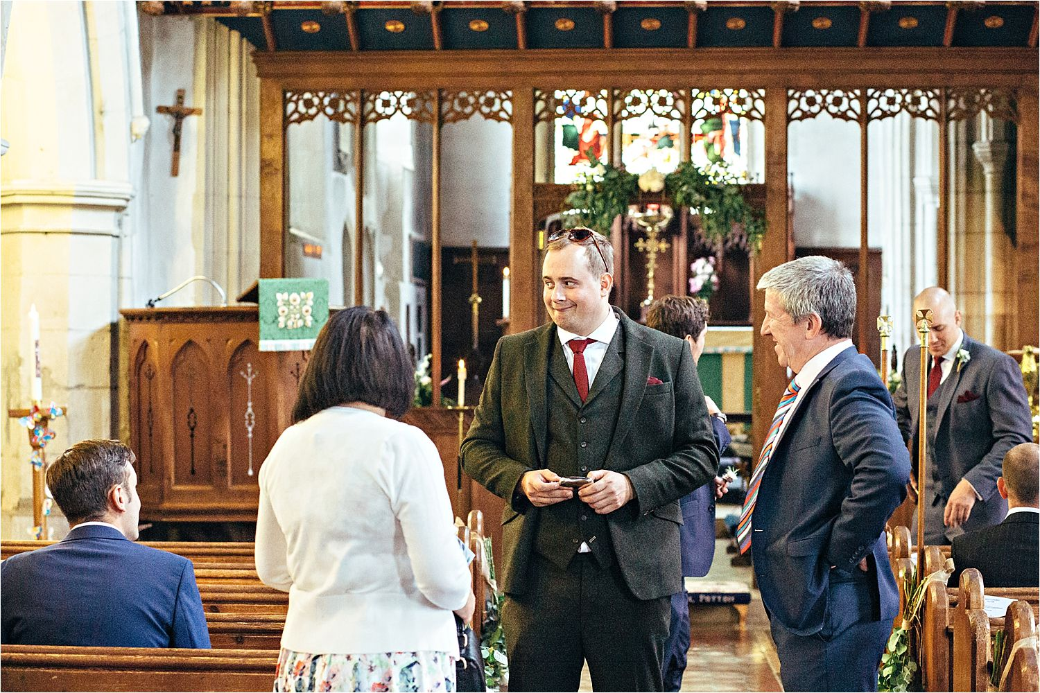 Guests mingling in church for wedding in Bedfordshire