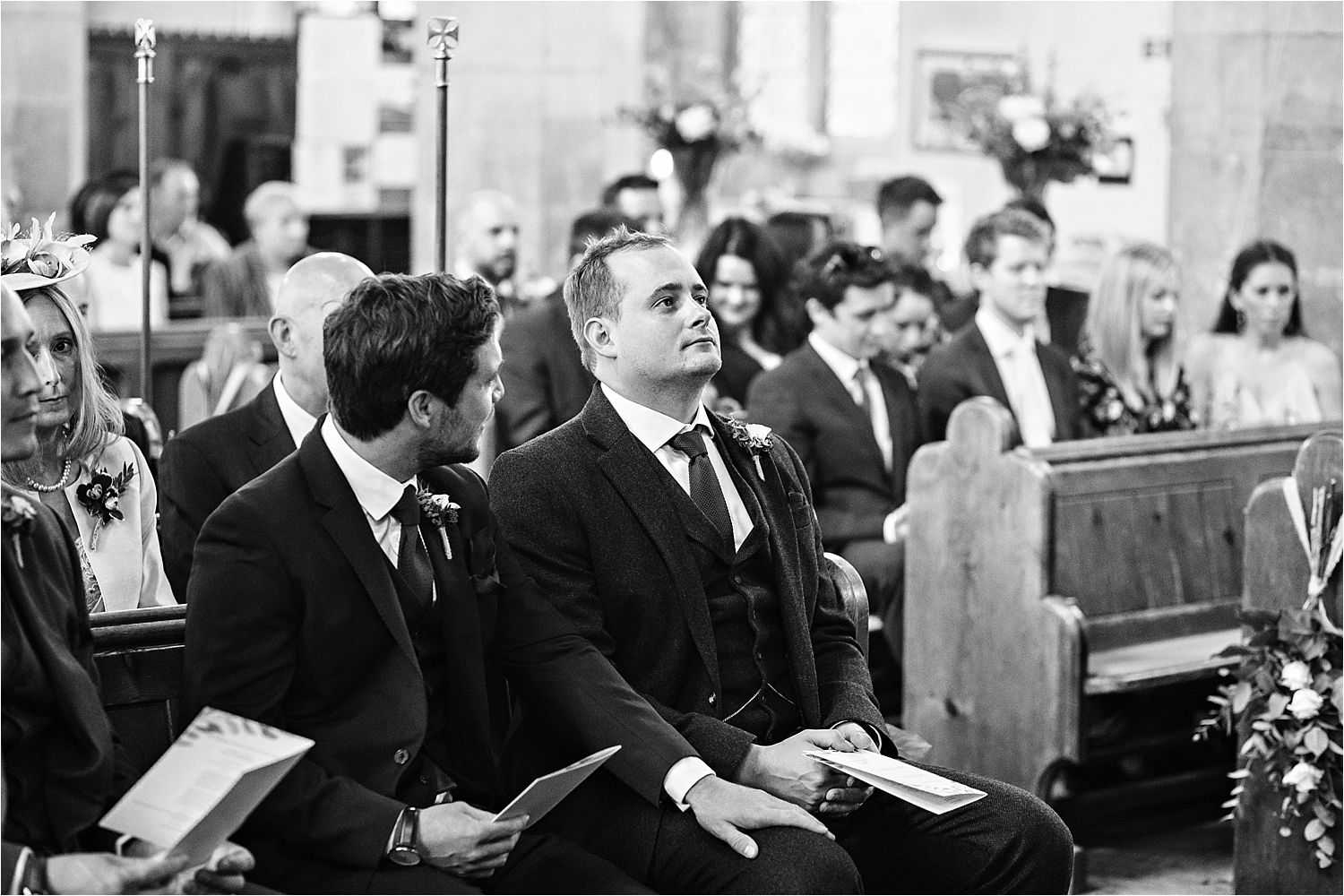 Bridegroom takes a deep breath as he waits for his bride to arrive at Bedfordshire church
